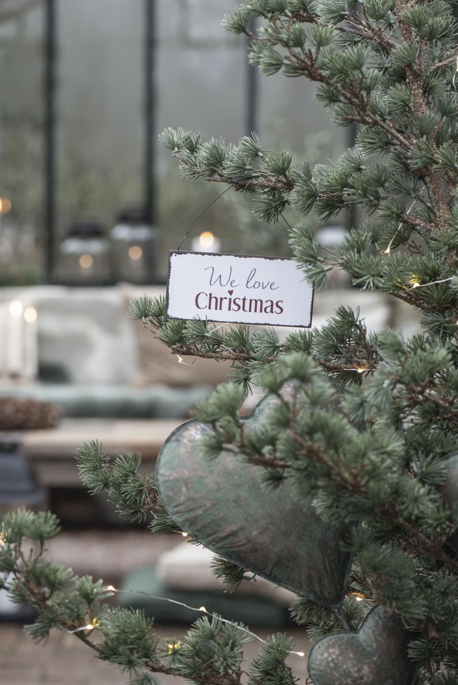"Schild ""We love Christmas"""